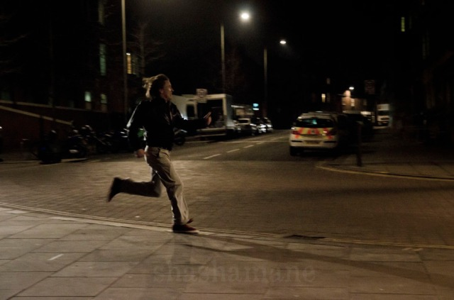 night scene, alan running towards city hall