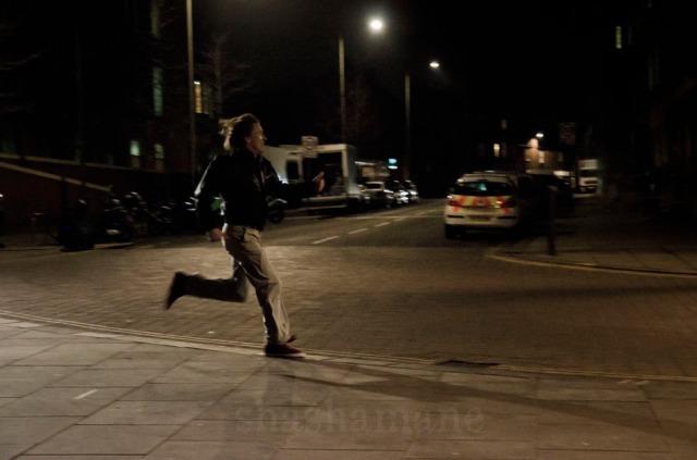 night scene, alan running towards city hall