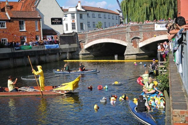 The annual Norwich duck race descended into farce, chaos and controversy today, when with a breeze stronger than the riverflow, and in the opposite direction, the ducks had to be towed to the finish line, but they still all showed a strange reluctance to cross the line, until an unscrupulous duck jumped into the river near the finishing line, at which point total pandemonium ensued.