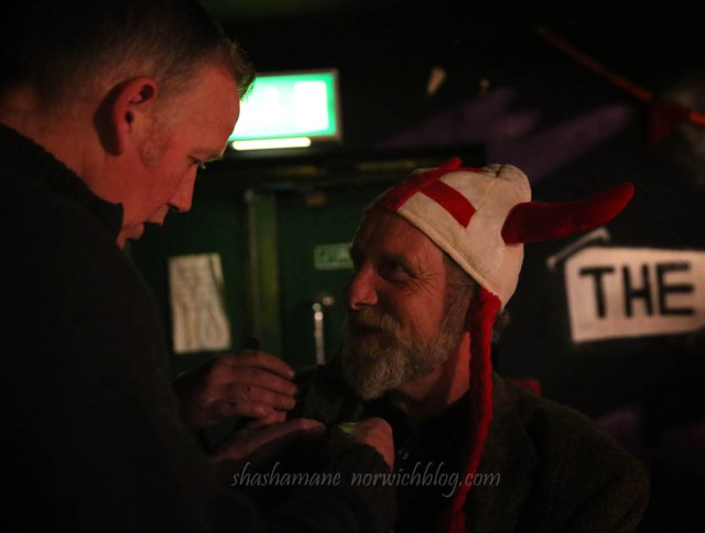 Steve Pulford pins a badge of Adrian's lapel